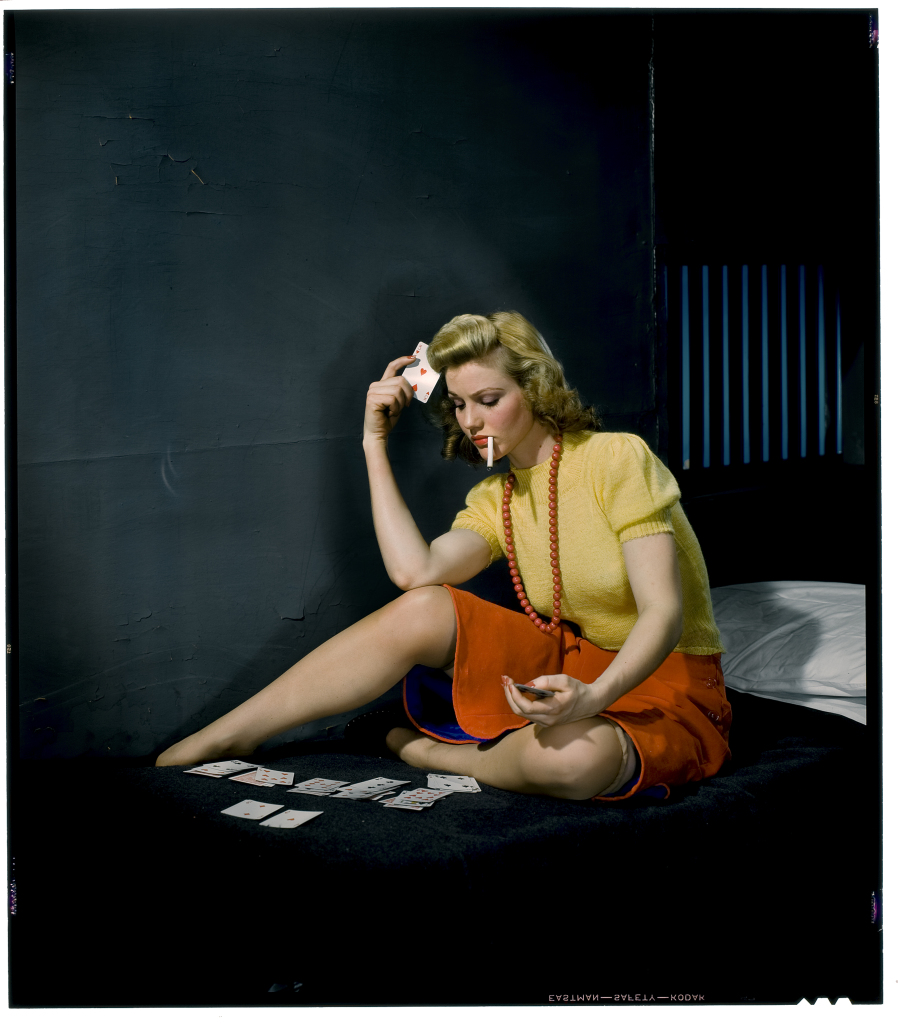 05 - Woman in cell, playing solitaire