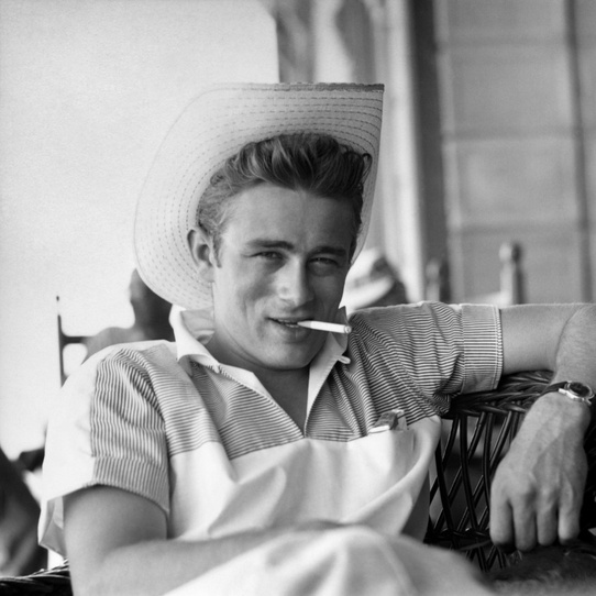 "James Dean photographed on the set of the film ""Giant"" in 1955, © Sid Avery / mptvimages.com"